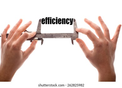"""Color horizontal shot of two hands holding a caliper and measuring the word """"efficiency""""."""