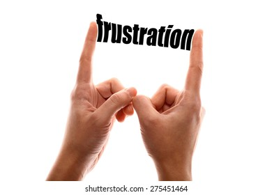 """Color horizontal shot of a of two hands squeezing the word """"frustration""""."""