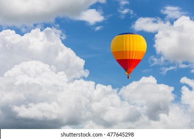 color hot air balloon and blue sky with clouds closeup