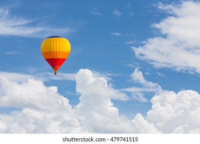 color hot air balloon in blue sky with clouds closeup