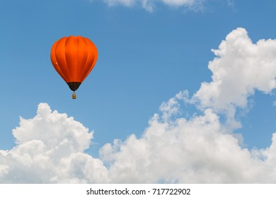 color hot air balloon in blue sky and cloud background