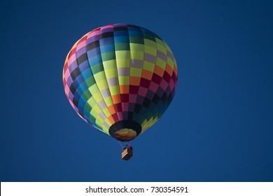 color hot air balloon in blue sky background