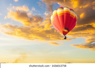 color hot air balloon in sky at sunset and cloud background