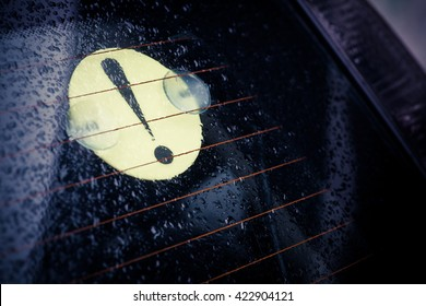 Color image of a beginner driver sign stuck on a car's windshield.