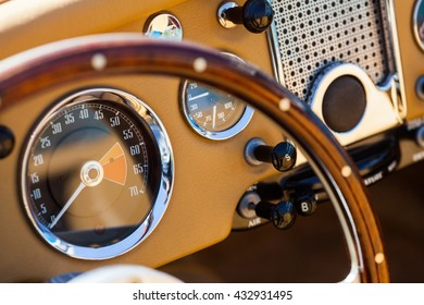 Color image of the dashboard of a retro car.