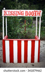 Color image of an empty kissing booth.
