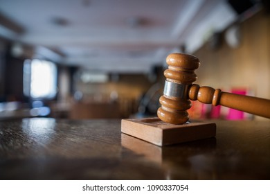 Color image of a hammer in a courtroom.