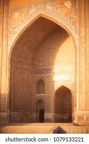 Color image with a madrasa detail in Bukhara, Uzbekistan.