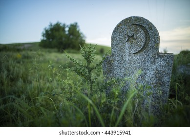 Color image of a Muslim tomb stone in an abandoned cemetery.