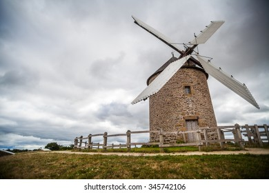 Color image of an old wind mill.