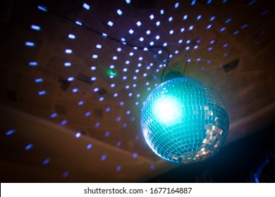 Color image of a shiny disco ball in a night club.