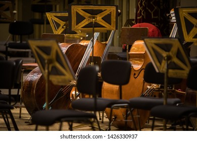 Color image of some orchestra empty seats on a stage.