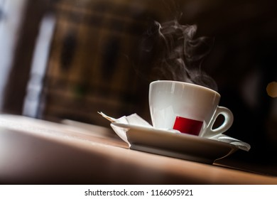 Color image of some steam coming out of a coffee cup.