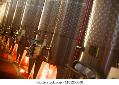 Color image of some steel tanks in a wine cellar.