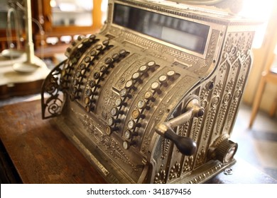 Color image of a vintage cash register.