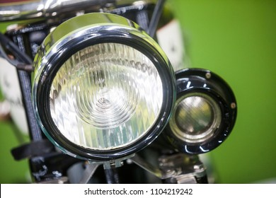 Color image of a vintage motorcycle headlight.