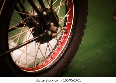 Color image of a vintage motorcycle wheel.
