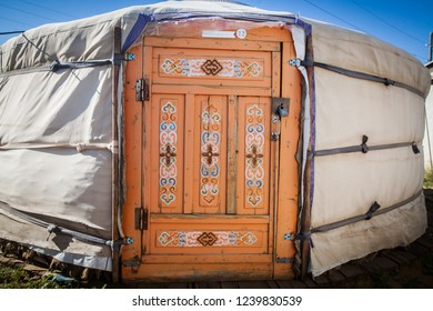Color image of the wooden door of a yurt in Mongolia.