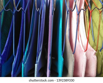 Color knitwear on hangers, top view