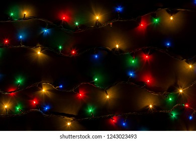 color lights of a garland on black background