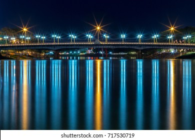 The color of the lights on the bridge in Phitsanulok, Thailand.