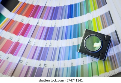 Color management in printing process with magnifying glass and color swatches