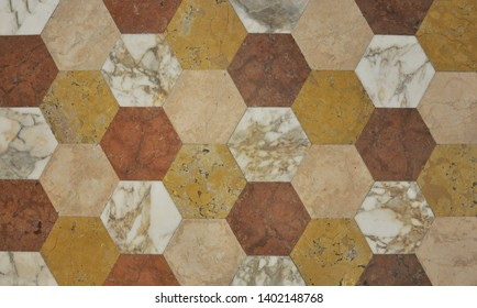 Color marble from hexahedron as a background. Modern hexagonal paving tiles from natural stone