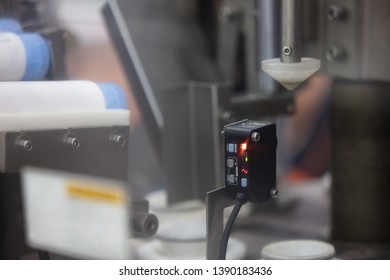 Color Mark Sensor, Photoelectric Sensor installed on Packaging Line in factory.