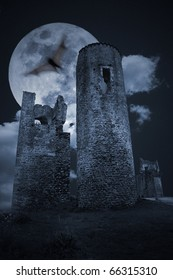 Color medieval scenery with full moon and remote medieval european ruins (added some digital grain)