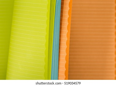 color memo pad with spring paper with horizontal stripes, closeup