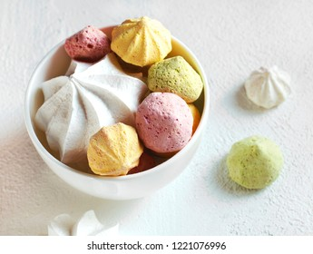 Color meringues on a white background