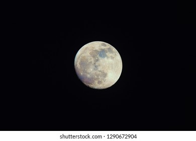 Color Moon on night sky. Natural colors of our satellite emphasized in postproduction