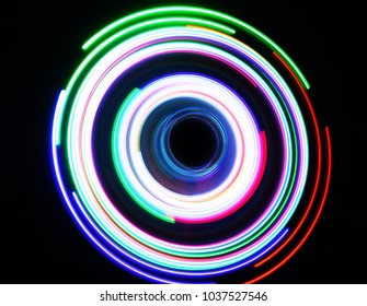 Color neon circles at long exposure shot. Neon color lights abstract painting . Abstract lights at motion exposure time slow shutter speed effect.