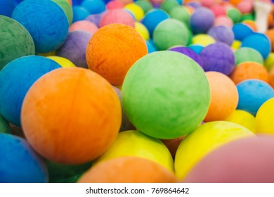 Color nice Rainbow dragee balls background. Colorful playing balls