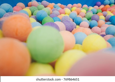 Color nice Rainbow dragee balls background. Photo Pattern design for banner, poster, flyer, card, Colorful plastic balls playground indoors