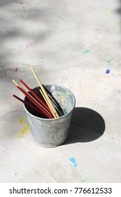 color paint brush in the bin in vertical frame