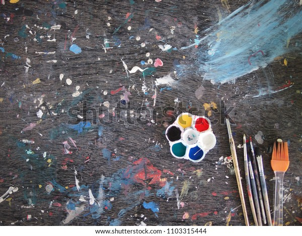 The color painted table with paintbrush and palette