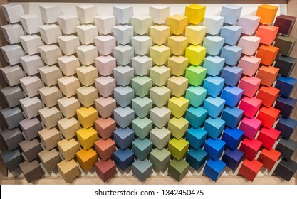 Color palette. Display with colored paint pantones for interior decoration. Multicolored square cube bars painted with paints of all colors