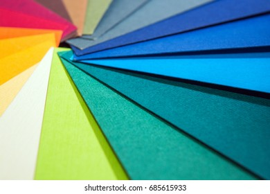 Color palette guide. Colored textured paper samples swatch catalog. Bright and juicy rainbow colors. Beautiful abstract background. Back to school. Office accessories.