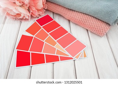 Color Palette Guide in on white Background. Interior flatlay. Color of the year 2019 coral