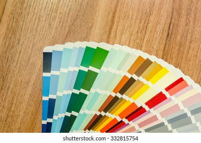 color palette guide on wooden board close up view