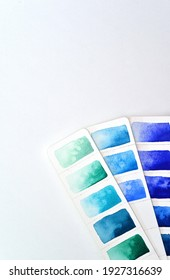 Color palette, three strips of paper with blue and sea shades, watercolor paper. For color selection, training, lies on a white background, there is a place for text, signatures.