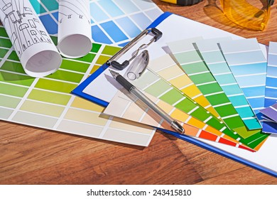 color  palettes on wooden table