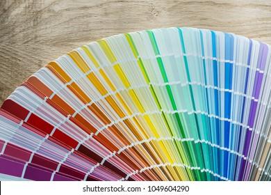 Color pantone fan on wooden meter