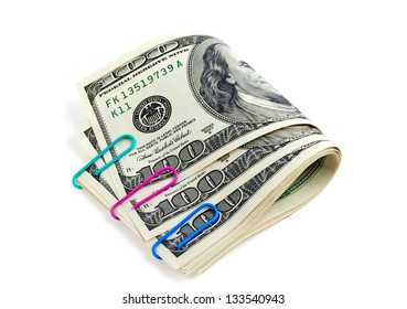Color paper clips with dollars on a white background
