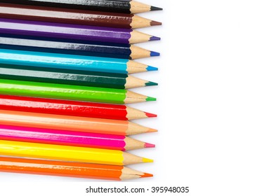 color pencil on white with copy space, colorful kids school artist concept.