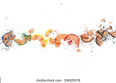 Color pencil shaves in line on a white paper