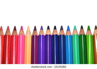 Color pencils arrange in a straight line isolated on white