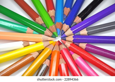 Color pencils arrange in a wheel colors isolated on white