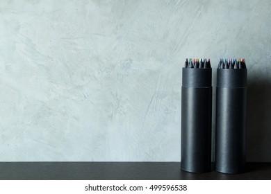 Color pencils in black box gray background